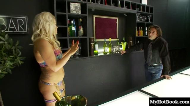 Tiffany Kingston is a busty blonde whore with a tattooed body and a